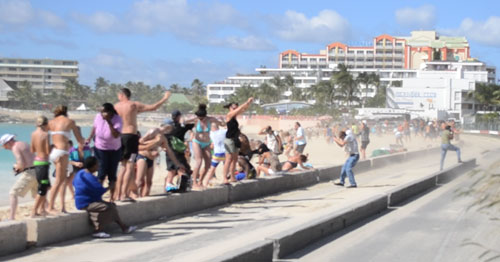 people getting sandblasted from jetblast on maho beach at princess juliana airpot, maho beach